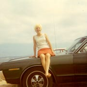 Donna Kleinmaus sits on a 1967 Mercury Cougar, which was owned by her now husband, John Kleinmaus, in 1969.