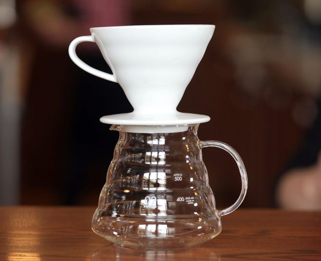 A Hario V60 ceramic drip cone is one of the brewing methods participants learn in a class at the Stone Creek Coffee Factory Store, 422 N. Fifth St.