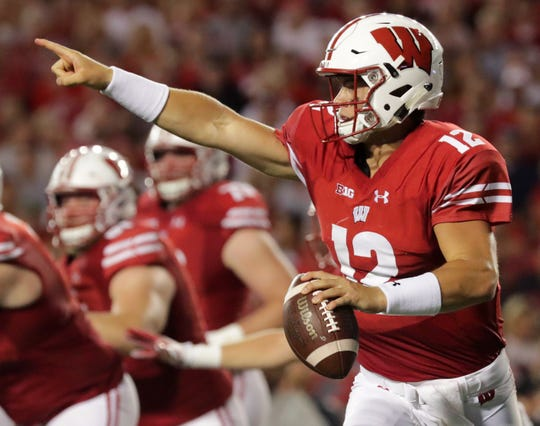 Wisconsin quarterback Alex Hornibrook (12) rolls out during the second quarter their game Friday, August 31, 2018 at Camp Randall Stadium in Madison, Wis. Wisconsin beat Western Kentucky 34-3.  MARK HOFFMAN/MHOFFMAN@JOURNALSENTINEL.COM