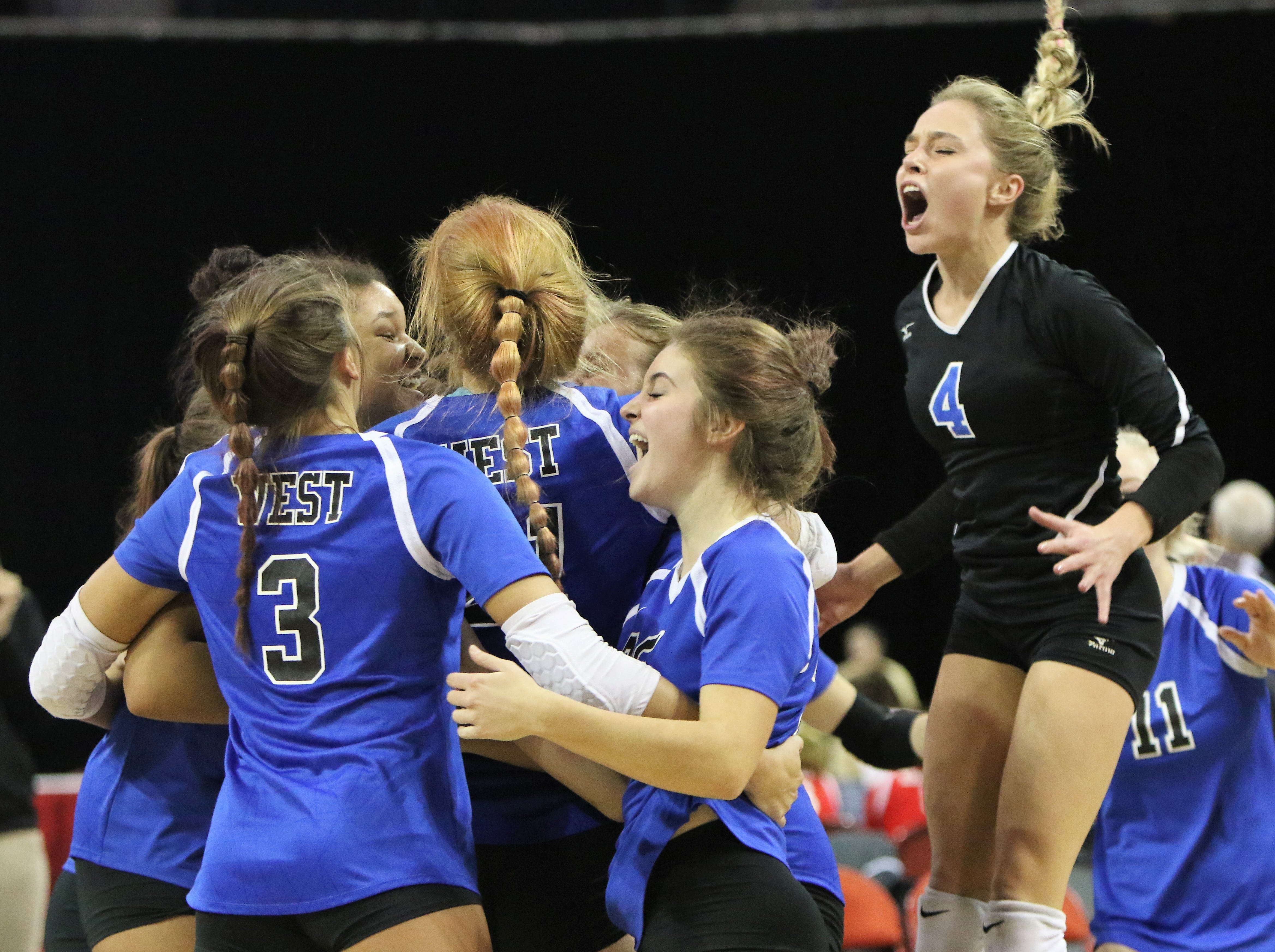 Waukesha West sophomore Anna Holland (4) jumps for joy as the Wolverines celebrate their quarterfinal win over Arrowhead at the WIAA state girls volleyball tournament on Thursday, Nov. 1.