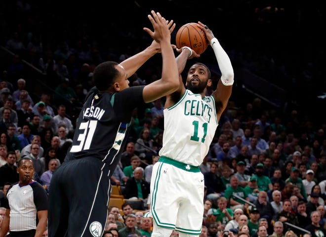 Kyrie Irving paced the Celtics' three-point barrage against John Henson and the Bucks by going 6 of 12 from deep as he finished with a team-high 28 points on Thursday night.