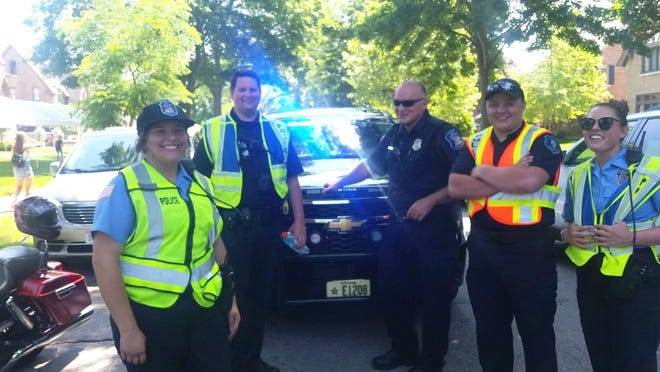 Auxiliary officers helped Whitefish Bay police direct traffic during this year's Fourth of July festivities. Pictured are (from left) Community Service Officer Jenna Kunath, Lt. Andrew Mroz, Auxiliary Officer Richard Domach Jr., Auxiliary Officer Eric Ranchau and Community Service Officer Julia Zurfluh. The Whitefish Bay Police Department is seeking more auxiliary officers to help with community events.