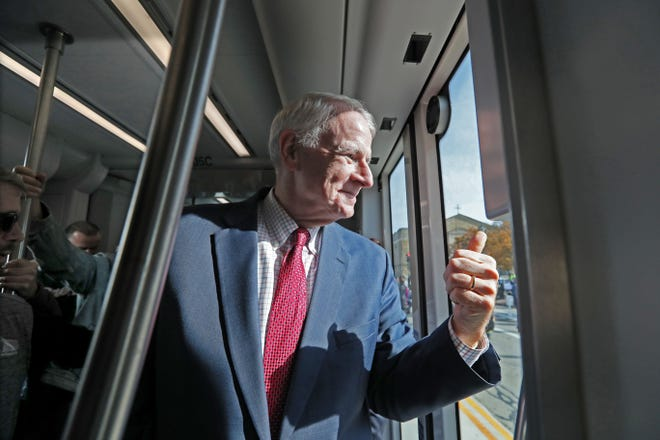 Mayor Tom Barrett flashes the thumbs-up as the streetcar leaves Cathedral Square.
