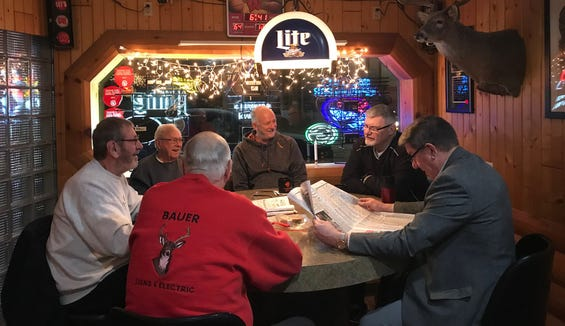The early morning coffee crowd at Randall's Uptown Tavern in Mauston one morning last December. From left to right: Larry Purvis, Harlow Gierhart, Phillip Bauer (backed turned), Christopher Swan, Dan May and Paul Schaller.