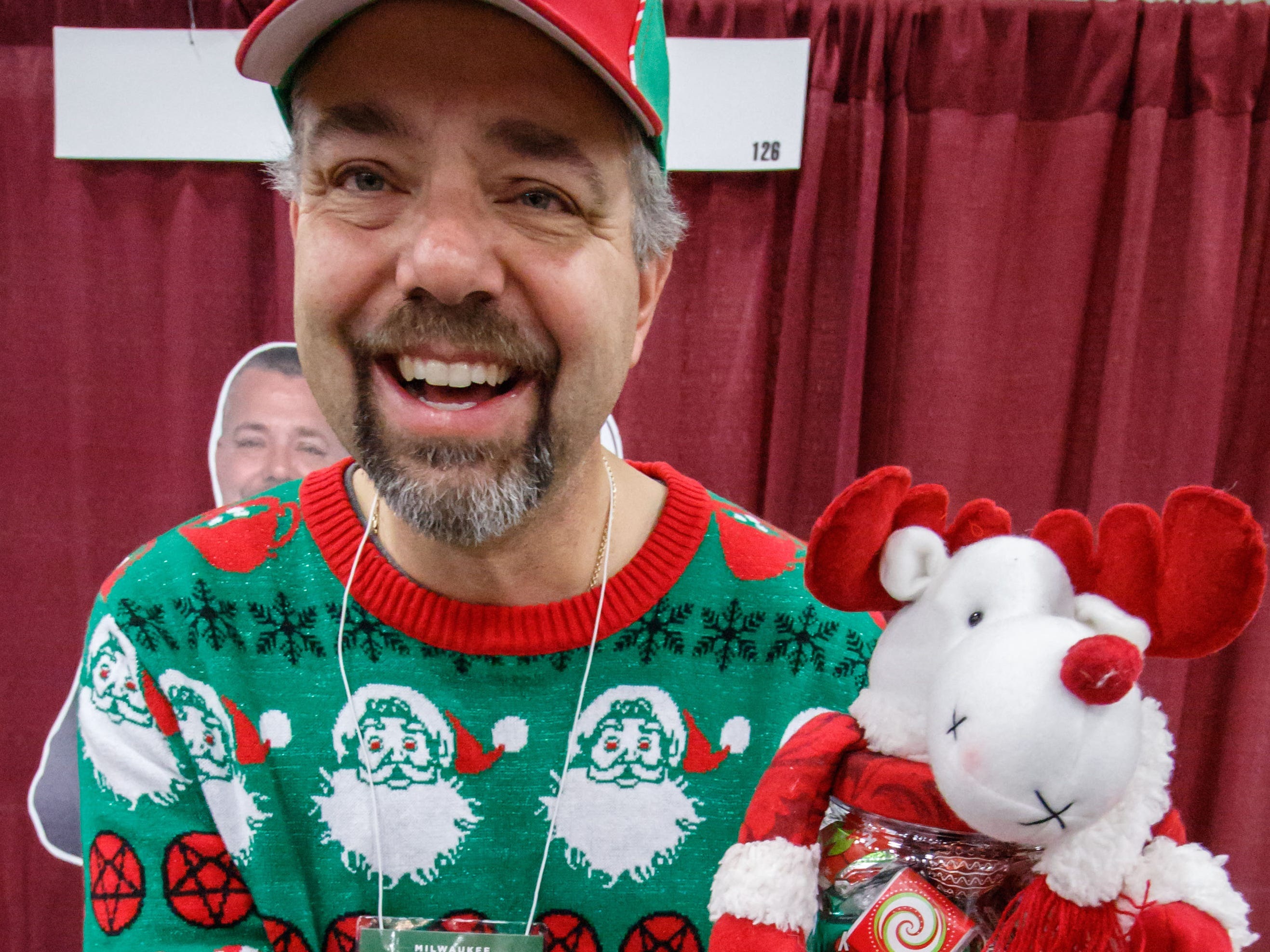 Scott Rondeau of Sweet to Eat gifts in Wauwatosa tempts shoppers with holiday themed candy gifts during the Milwaukee Holiday Boutique at Wisconsin State Fair Park on Friday, Nov. 2, 2018. The event features over 200 vendors, pictures with Santa, live entertainment and much more.