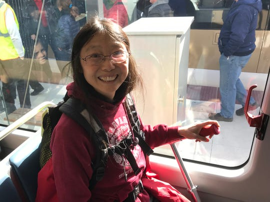 Alverno psychology professor Joyce Tang Boyland rides The Hop.