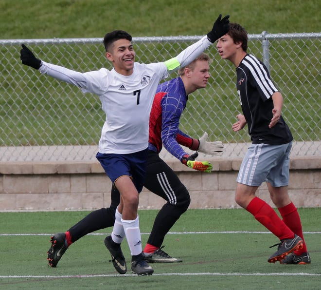 Pius XI's Ivan Cuellar celebrates one of his three goals he scored against Baldwin-Woodville in a Division 3 semifinal match on Thursday at Uihlein Soccer Park in Milwaukee, Wis.