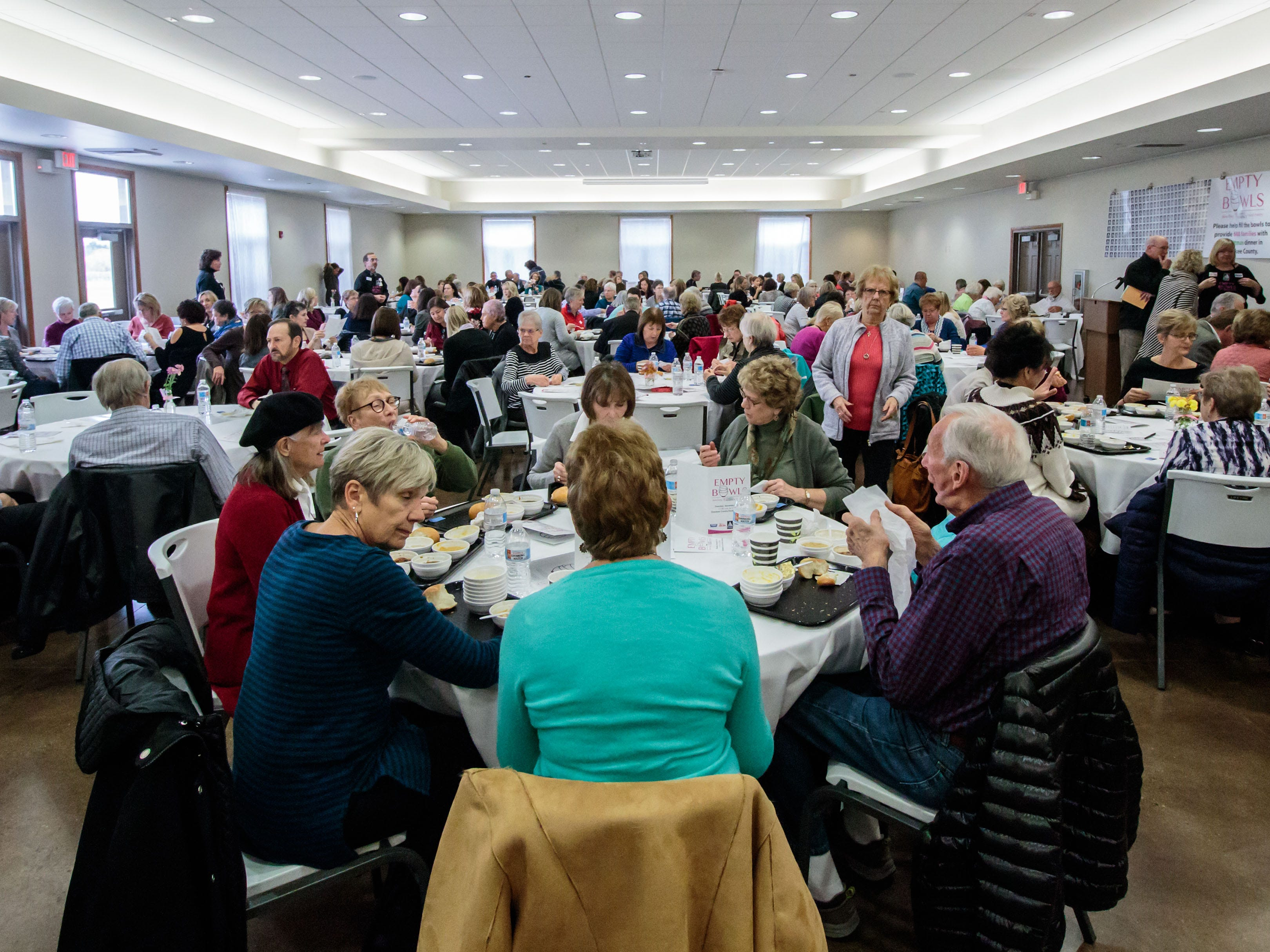 Attendees enjoy a delicious lunch during the Empty Bowls fundraising event at the Ozaukee Pavilion in Cedarburg on Thursday, Nov. 1, 2018. Proceeds from the event will benefit Family Sharing's food pantry and provide 600 Ozaukee County families with Thanksgiving dinners.