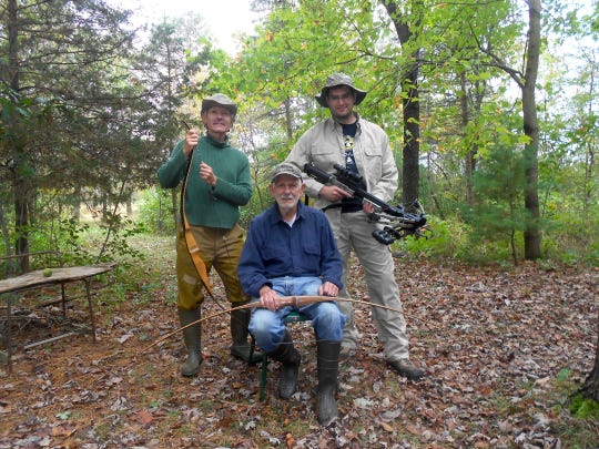 Ralph Schwalbach, 83, (center) of West Allis sits for a family portrait with his son Randall Schwalbach, 58, (left) of Appleton and grandson Joseph Steven, 27, of Wauwatosa. The men enjoy deer hunting together on a property in Waushara County that Ralph purchased in 1966.