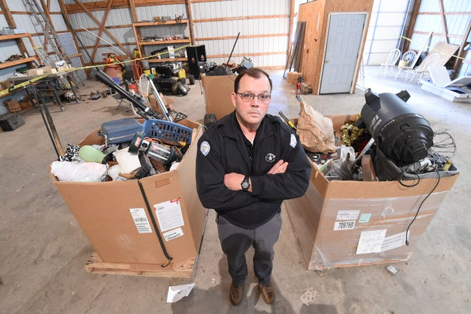 Marion County Sheriff Clinton Evans stands in front of three large boxes of unclaimed items seized as part of a theft investigation. The sheriff said his department will be putting extra effort into solving theft cases and seeing those responsible punished. He's asking for the public's help in making their efforts successful.