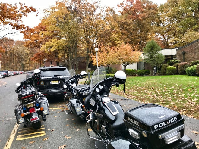 Police escort waits outside the St. Clement Church in Dover during the funeral Mass for Dr. Mark Quadrel of Rockaway Township.