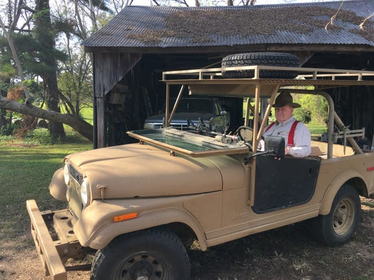 Jim Jenkins in the farm Jeep.