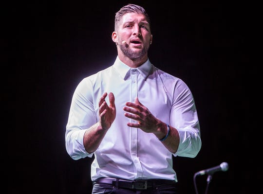 former NFL player and current minor league baseball player Tim Tebow speaks at the Fields of Faith event Nov. 1 at Worthen Arena in Muncie, Indiana.