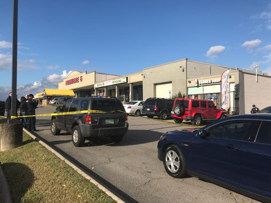 Crime scene tape appears outside Eclips BarberShop in Murfreesboro after a Friday afternoon shooting. The suspect is at large, but police said the victim and shooter appeared to know each other.