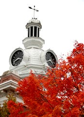 Birds rest on the top of the cupola and weather vane of the Rutherford County Courthouse in Murfreesboro as trees begin to change color and fall from their branches on the first day of November around the Murfreesboro Public Square on Thursday, Nov. 1, 2018.