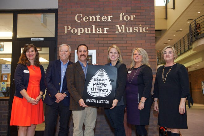 Officials from the Tennessee Department of Tourist Development presented MTSU's Center for Popular Music with a marker designating it as a Tennessee Music Pathways site. The center is located at the Bragg Media and Entertainment Building on the MTSU campus.