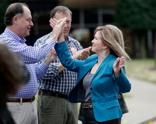 U.S. Rep. Marsha Blackburn, right, the Republican nominee for Senate, is greeted by State Sen. Jack Johnson, R-Franklin, left, as Blackburn arrives to vote Wednesday, Oct. 31, 2018, in Franklin, Tenn.