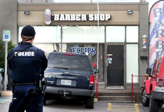 The Murfreesboro Police Department works a crime scene at Eclips Barber Shop in Murfreesboro after a shooting, on Friday, Nov. 2, 2018. The suspect is at large, but police said the victim and shooter appeared to know each other.