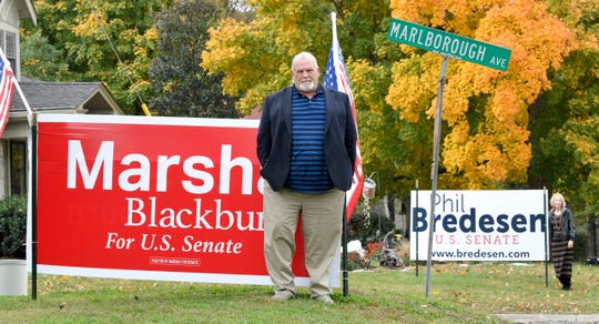 Nashville neighbors Billy Inman and Katherine Willey have large dueling Blackburn/Bredesen campaign signs in their front yards. They have a lighthearted rivalry that began during the 2016 presidential election.