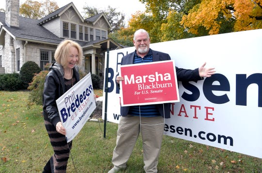 Nashville neighbors Katherine Willey and  Billy Inman joke around in Willey's front yard. They have large dueling Blackburn/Bredesen campaign signs in their yards, but also a lighthearted rivalry that began during the 2016 presidential election.