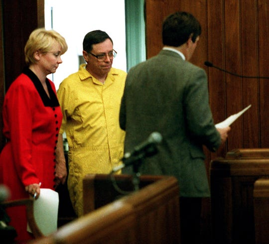 Former priest, Edward J. McKeown, center, enters court for his arraignment March 17, 1999. McKeown is currently in prison after pleading guilty in 1999 to raping a teenage boy when he was no longer a priest.