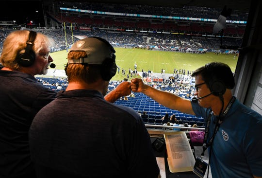 Titans Radio broadcasters Dave McGinnis, Rhett Bryan and Mike Keith congratulate each other as they call the Titans game against the Vikings Nissan Stadium for their radio broadcast of the game Thursday, Aug. 30, 2018, in Nashville, Tenn.