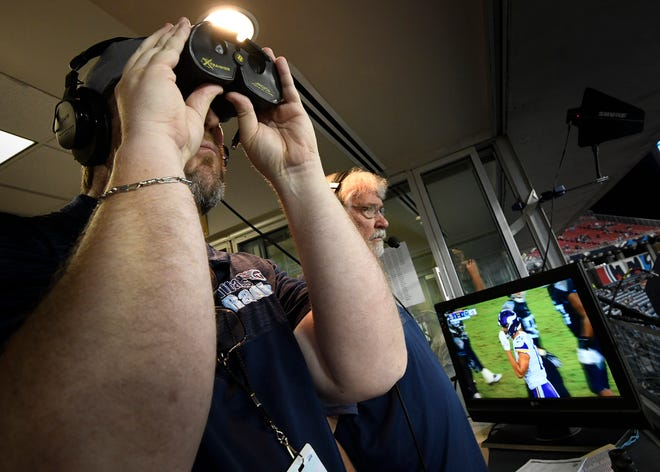 Titans Radio game day host Rhett Bryan works as a spotter for Mike Keith and McGinnis during their radio broadcast of the Titans game against the Vikings Nissan Stadium Thursday, Aug. 30, 2018, in Nashville, Tenn.