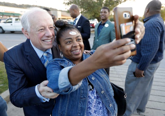 Former Gov. Phil Bredesen poses for a photo with Franchetta Greer as he campaigns for Senate Oct. 30 in Nashville.