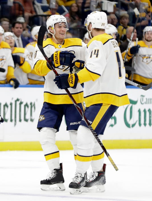 Mattias Ekholm and Kyle Turris celebrate Turris' goal Thursday against the Lightning.