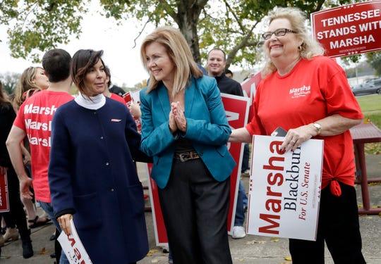 U.S. Rep. Marsha Blackburn, center, the Republican nominee for Senate, talks with supporters Oct. 31 in Franklin.