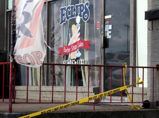 Crime scene tape appears outside Eclips Barber Shop in Murfreesboro after a shooting, on Friday, Nov. 2, 2018. The suspect is at large, but police said the victim and shooter appeared to know each other.