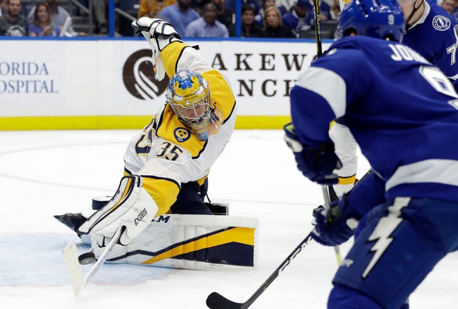 Nashville Predators goaltender Pekka Rinne (35) makes a save on a shot by the Tampa Bay Lightning during the second period of an NHL hockey game Thursday, Nov. 1, 2018, in Tampa, Fla. (AP Photo/Chris O'Meara)