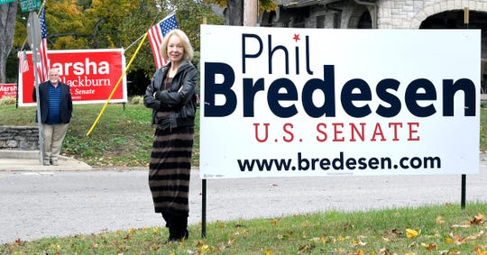 Nashville neighbors Katherine Willey and  Billy Inman have large dueling Blackburn/Bredesen campaign signs in their front yards. They have a lighthearted rivalry that began during the 2016 presidential election.