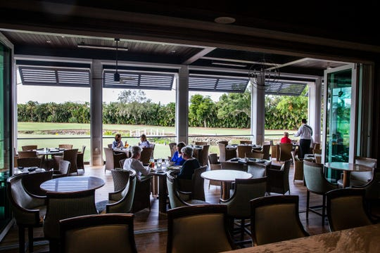 People enjoy lunch at The Veranda, a 64-seat outdoor dining spot, at the Country Club of Naples on Friday, November 2, 2018. Overlooking the first hole of the golf course and the putting green, The Veranda serves the same food asÊthe Tavern by the Green, a casual, indoor restaurant with bar, pub and bistro menus, which was also greatly expanded as part of the last renovation.