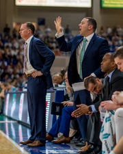 The style of first-year FGCU coach Michael Fly (hand raised) will be much different than that of Joe Dooley (left), who is at East Carolina after five seasons with the Eagles.