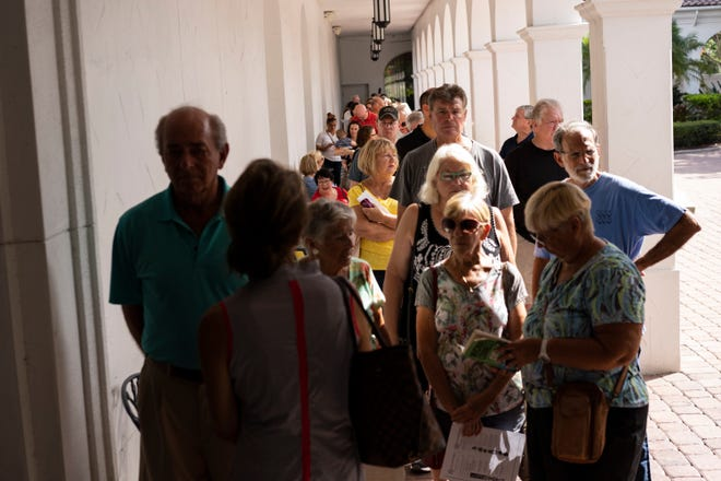 Voters line up for one of the last days of early voting Nov. 2, 2018, at Collier County Public Library Headquarters in North Naples, Florida.