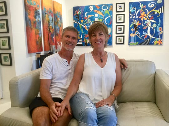 Steve and Cynthia Adams with their art