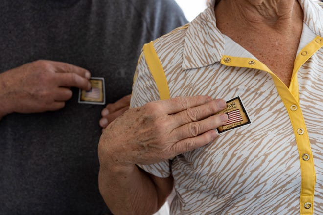 "James and Marcia Sanchack, of Naples, stick their ""I voted today"" stickers after exiting the polling area on Friday, Nov. 2, 2018, at Collier County Public Library Headquarters. Since early voting began on Oct. 25, 2018, voters have cast nearly 98,000 early ballots. Of those, more than 55,000 were cast by mail and nearly 43,000 were cast at early voting polling places. Early voting in Collier County will end on Saturday, Nov. 3, 2018."