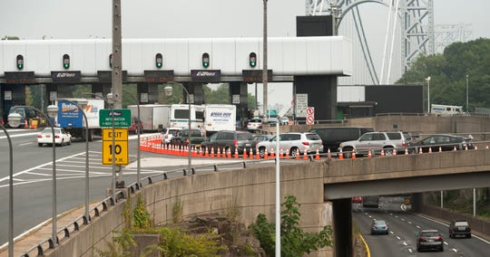 Sept. 12, 2013: Traffic entering the George Washington Bridge from Bruce Reynolds Boulevard is backed up at the tolls because the approach has been narrowed to one tollbooth, seen on far right.