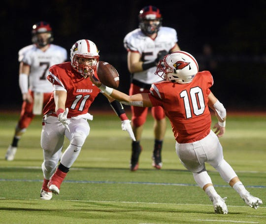 Glen Rock football at Westwood on Friday, November, 2, 2018. WW #10 Anthony Corrubia makes in interception in the first quarter. (left) WW #11 George Sengos.