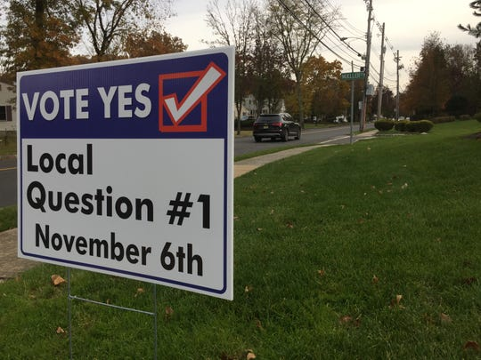 A sign staked on the front lawn of a house on Brooklake Road in Florham Park urges motorists to vote in favor of the school district's ballot question on Nov. 6.