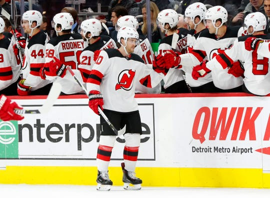 New Jersey Devils center Blake Coleman (20) celebrates his goal against the Detroit Red Wings during the second period of an NHL hockey game Thursday, Nov. 1, 2018, in Detroit.