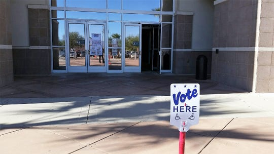 A sign at the Doña Ana County Government Center marks an early-voting site on Friday, Nov. 2, 2018, ahead of Election Day for the general election. Wide-ranging races, including governor and the 2nd Congressional District, appear on the ballot.
