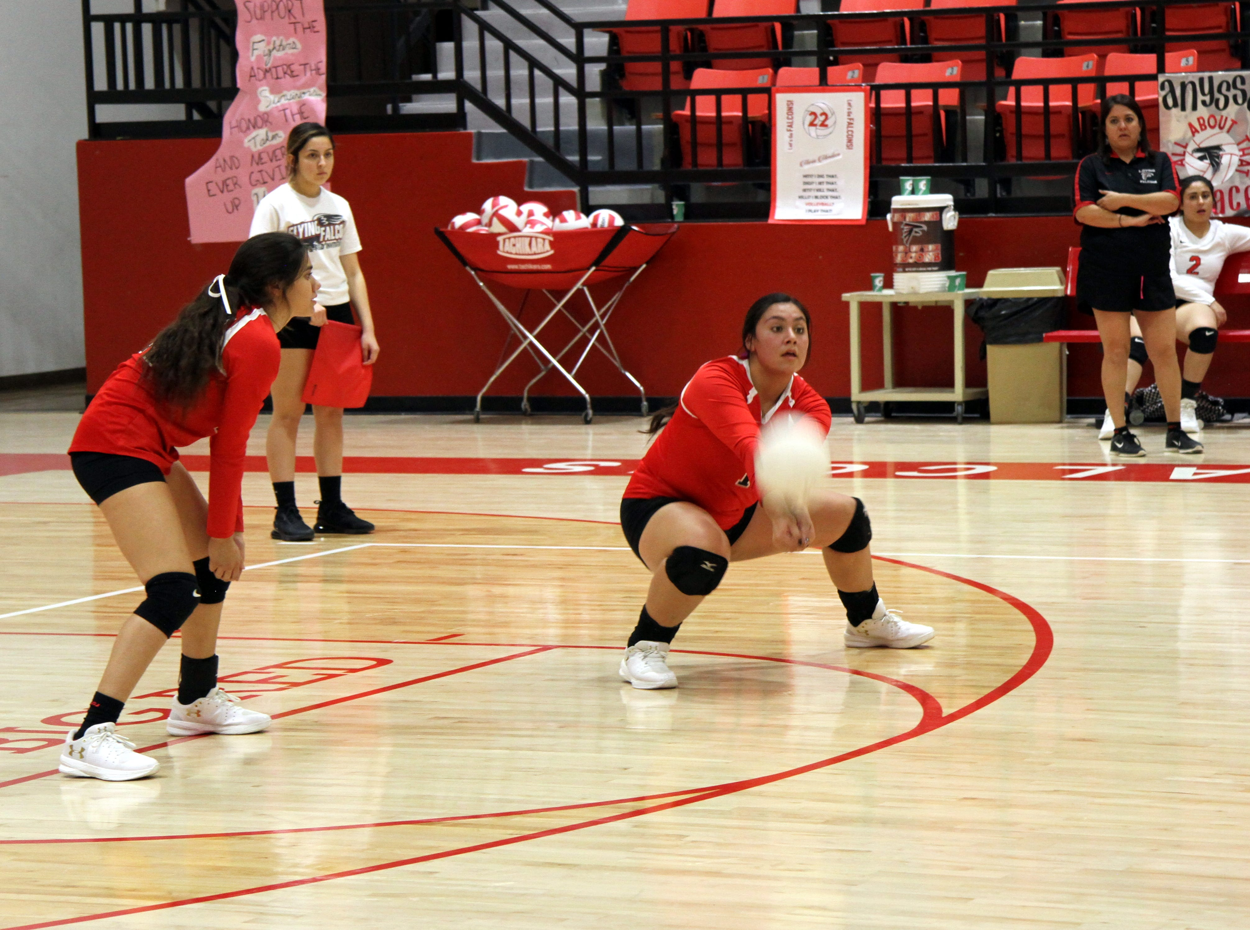 Andrica Gomez digs for a ball during Thursday's match against Eunice. Loving won in four sets.