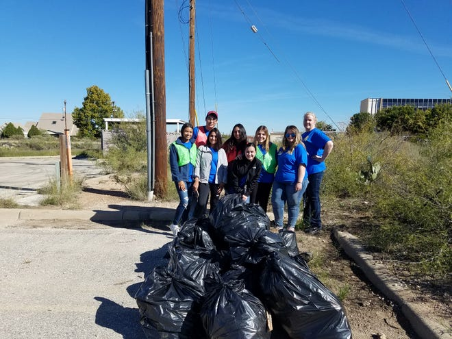 Kids from Carlsbad's Early College High School help Keep Carlsbad Beautiful pick up trash during United Way's Day of Caring Nov. 2, 2018.