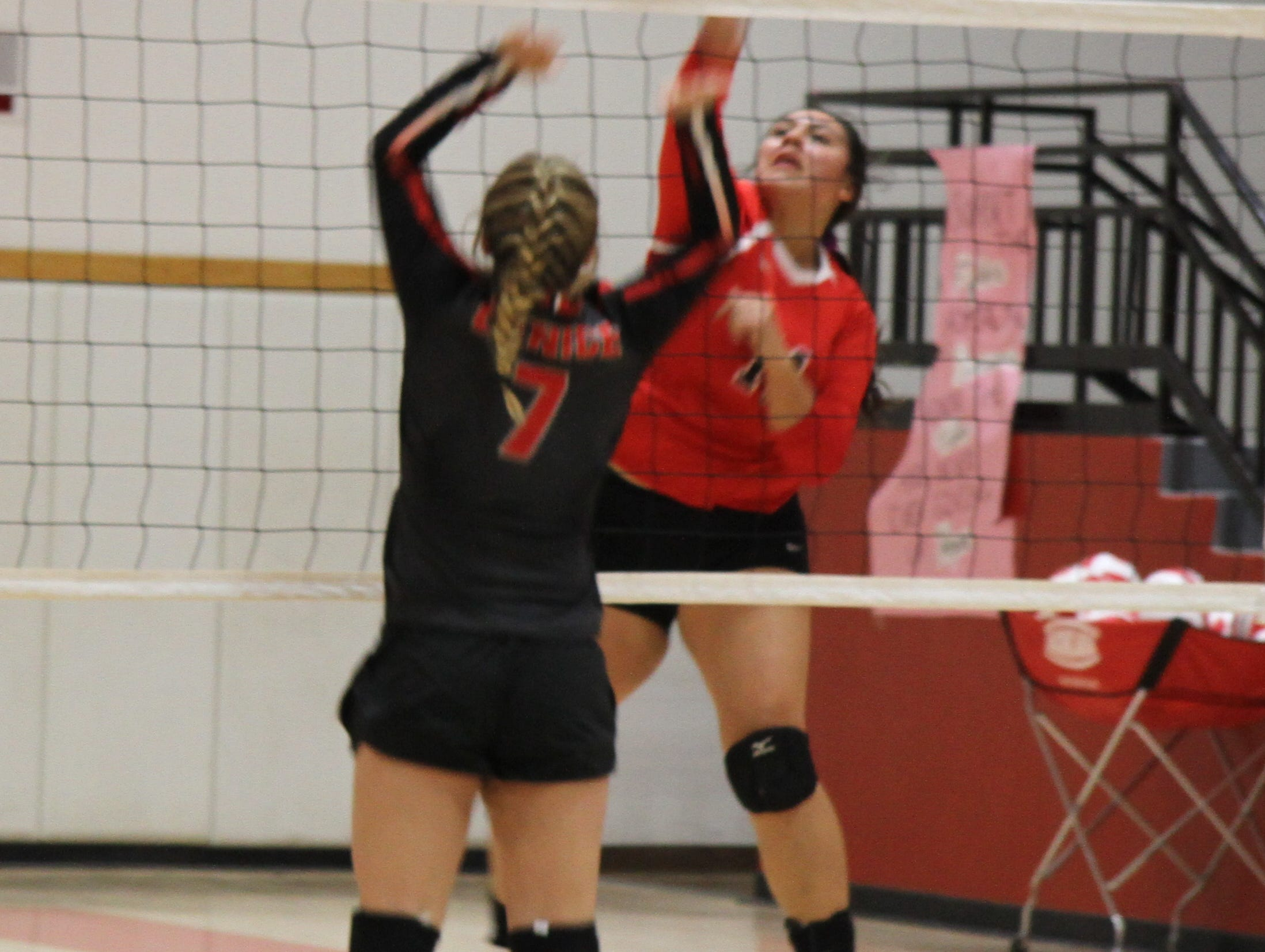Andrica Gomez spikes a ball during Thursday's match against Eunice. Loving won in four sets.