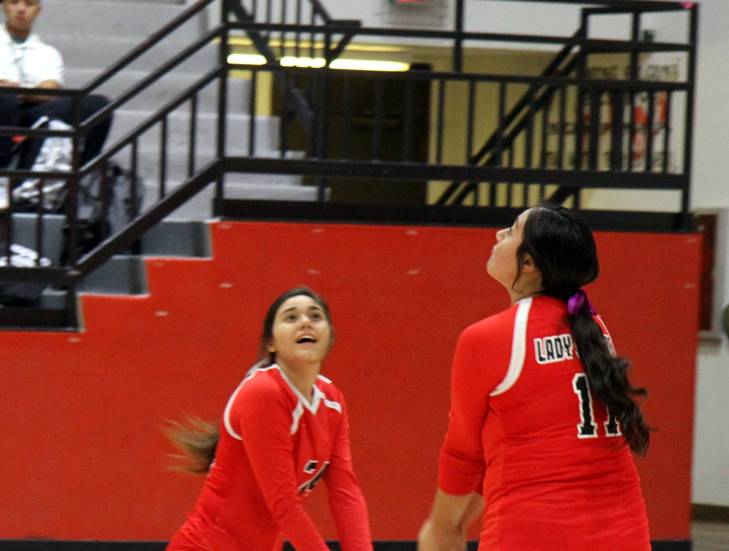 Frankie Hernandez, left, and Andrica Gomez go after a ball during Thursday's match against Eunice. Loving won in four sets.