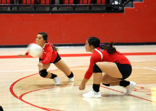 Anyssa Rodriguez, left, and Andrica Gomez dive for a dig during Thursday's match against Eunice. Loving won in four sets.