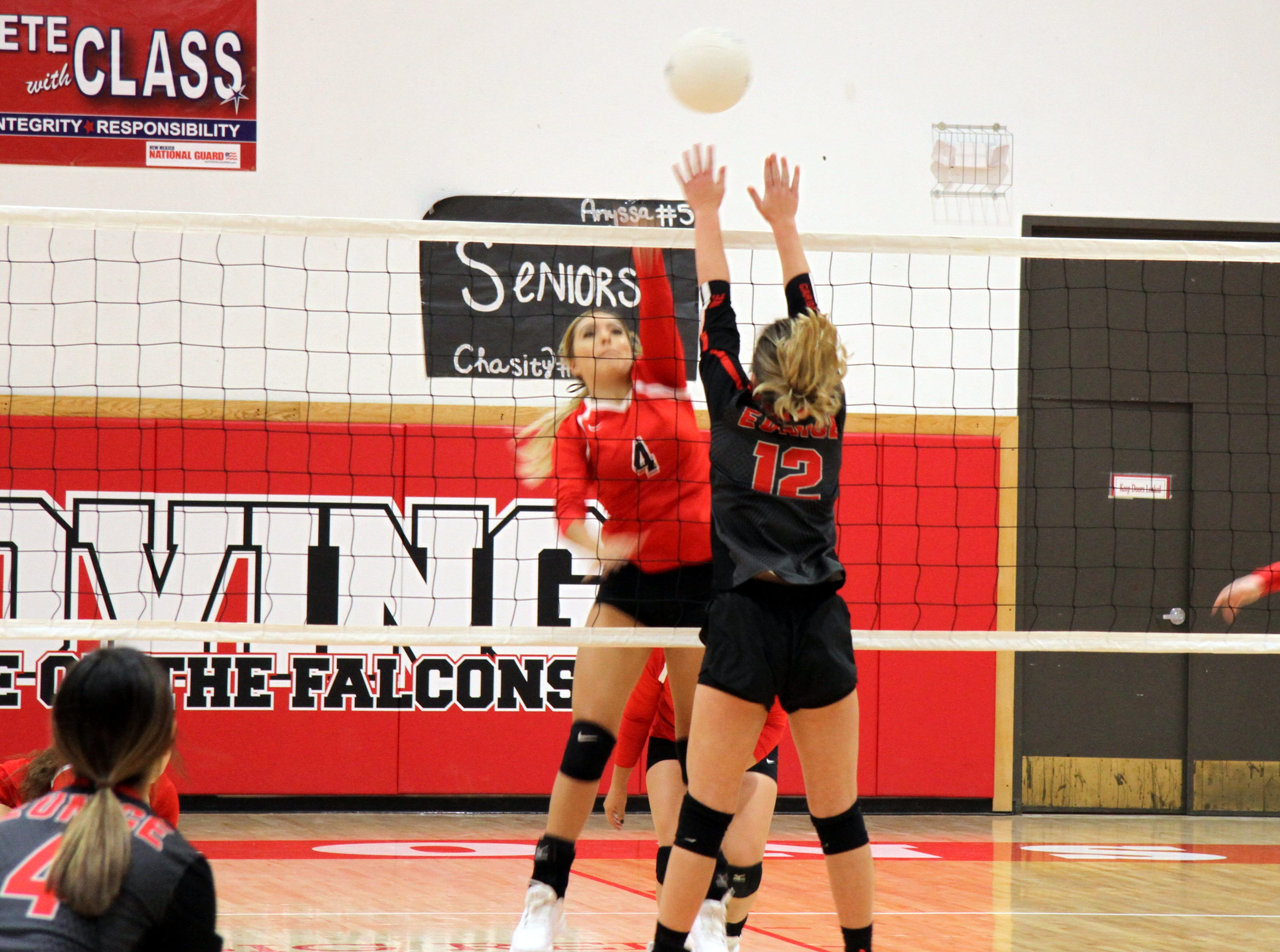 Chassity Onsurez spikes a ball during Thursday's match against Eunice. Loving won in four sets.