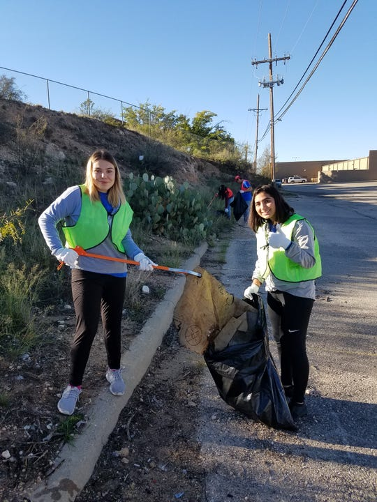 Kids from Carlsbad's Early College High School pick up trash behind the Carlsbad Mall Nov. 2, 2018 during the United Way of Carlsbad and South Eddy County's Day of Caring.